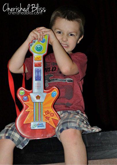 Aubrey Holding Guitar