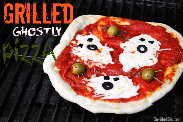 Grilled Halloween pizza with cheese ghosts and olive spiders. Too cute! The kids will love this! : )