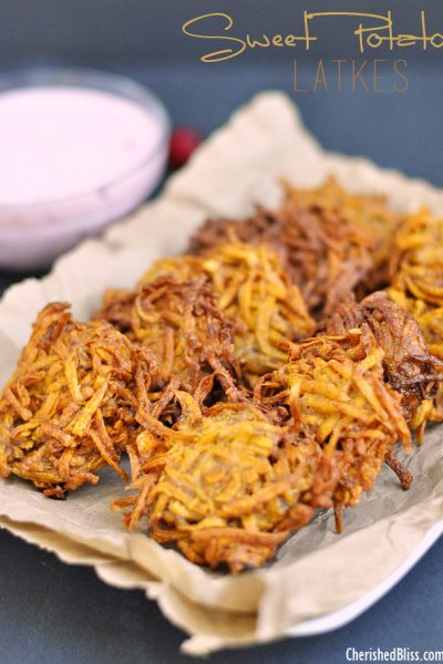 A Sweet Potato Latkes recipe with a Cranberry Jalapeno Dip that adds a delicious and spicy twist