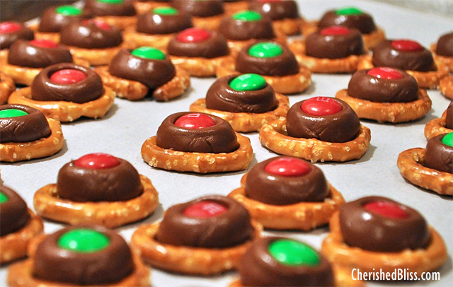 A fun treat for the holidays! Everyone is sure to love these M&M Kissed Pretzels!