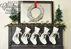 A Rustic Christmas Mantel featuring real cedar garland and drop cloth stockings