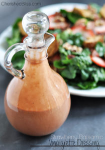 Enjoy this homemade Strawberry Balsamic Vinaigrette Dressing on your favorite salad!
