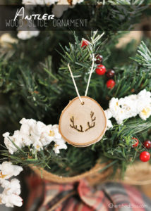 Add a rustic touch to your Christmas tree this year with these easy to make Antler Wood Slice Ornaments. Tutorial via cherishedbliss.com