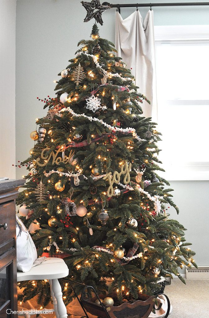 adorned with popcorn garland and rustic touches this old fashioned rustic christmas tree will bring