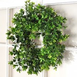 Add a beautiful wreath to your decor that will get you through ever season with this DIY Boxwood Wreath Tutorial via cherishedbliss.com