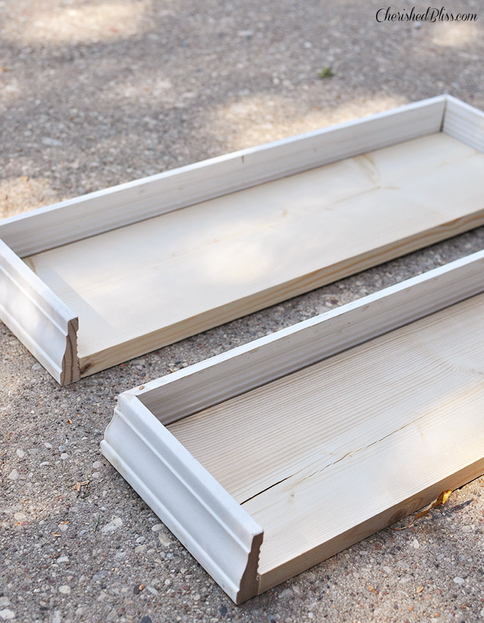 Build these easy Wooden Kitchen Shelves with just a few pieces of wood and trim. Get a quality product that costs less than store bought!