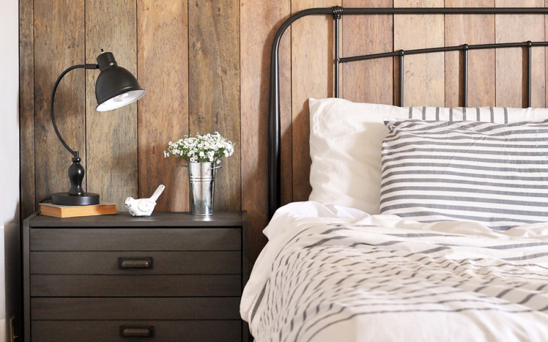 This Rustic Industrial Master Bedroom is warm, cozy, and inviting. The perfect place to wake up and drink a cup of coffee!
