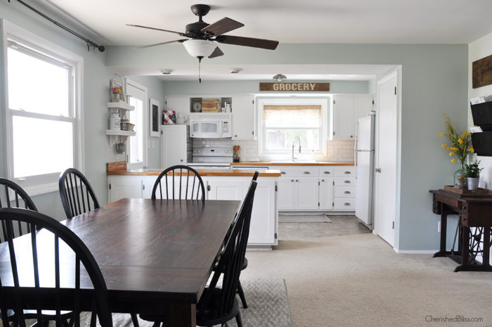 Before - This industrial farmhouse kitchen is both functional and inviting. Stainless steel appliances bring a professional industrial look while adding softer elements provides the comfort of a farmhouse.