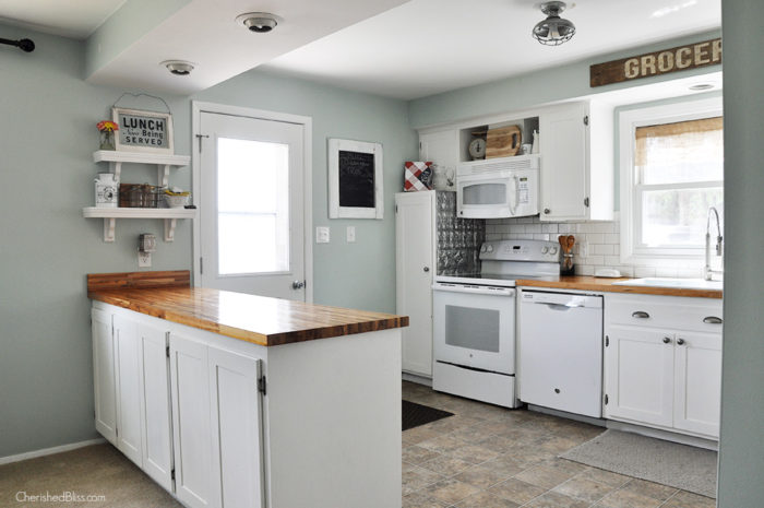 Before Picture - This industrial farmhouse kitchen is both functional and inviting. Stainless steel appliances bring a professional industrial look while adding softer elements provides the comfort of a farmhouse.