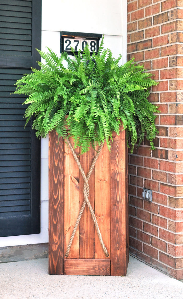 Build this Easy DIY Wooden Planter to add instant curb appeal to your home!