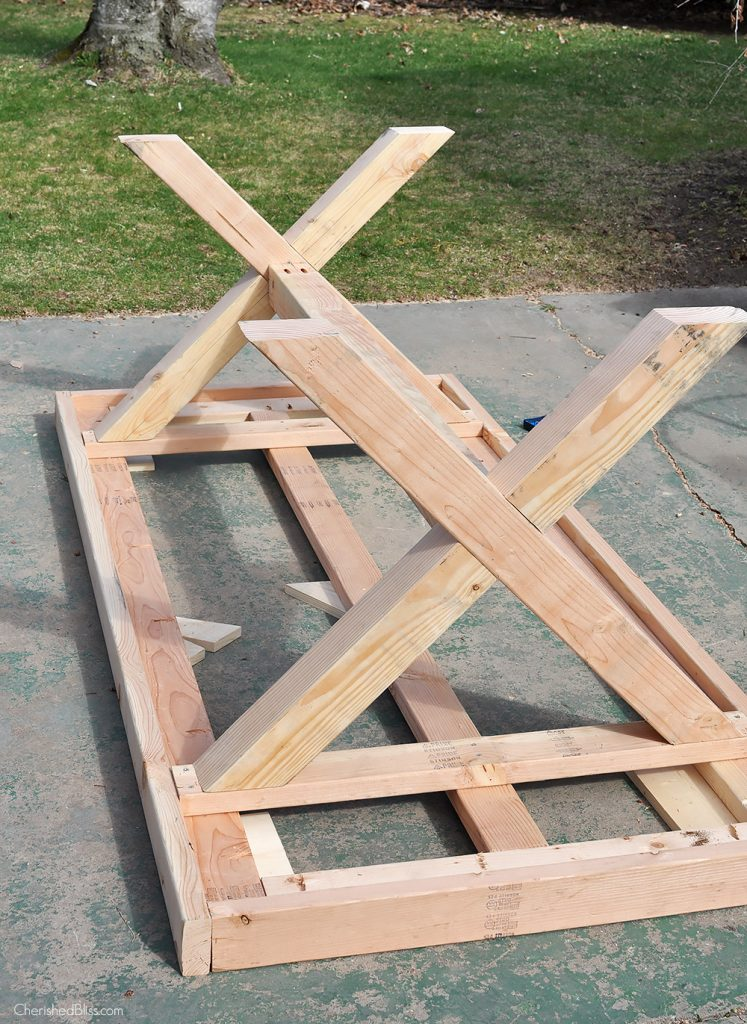 build this diy outdoor table featuring a herringbone top and x brace