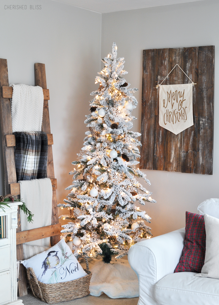 a simple white flocked christmas tree with white ornaments and a few rustic touches - Decorated Flocked Christmas Trees