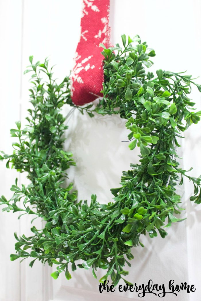 Christmas decor should inspire warmth, cuddling, and family gathering. These Mini Boxwood Wreaths by The Everyday Home Blog will keep your home cute and cozy this season!