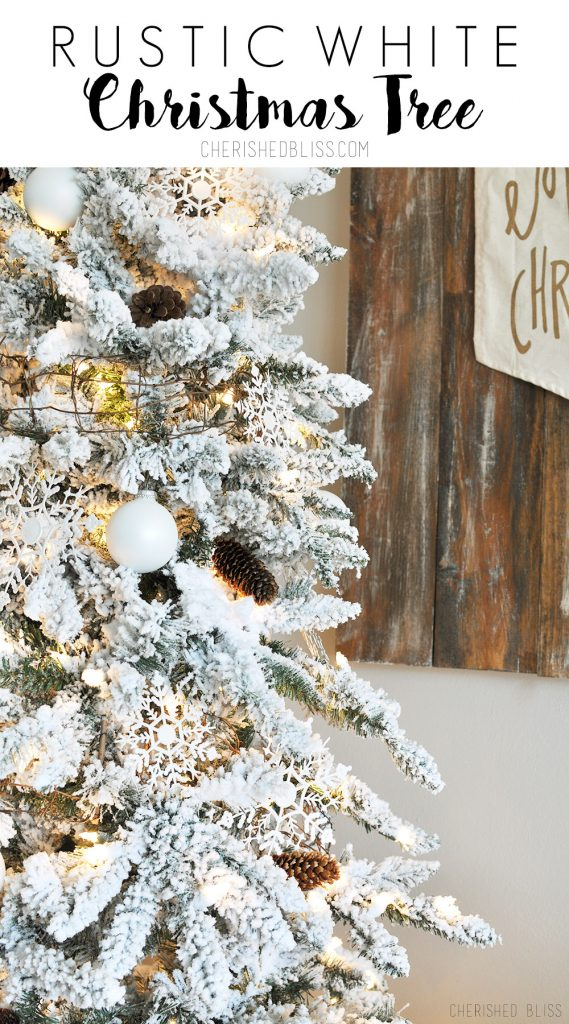 White rustic christmas decor - A Simple White Flocked Christmas Tree With White Ornaments And A Few Rustic Touches
