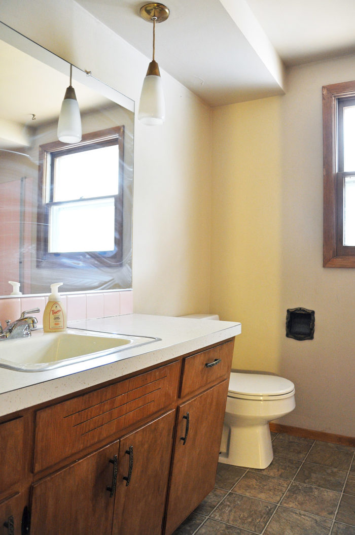THE BEFORE| Wait til you see this Industrial Farmhouse Bathroom! It is the perfect blend of styles and creates such a cozy atmosphere!