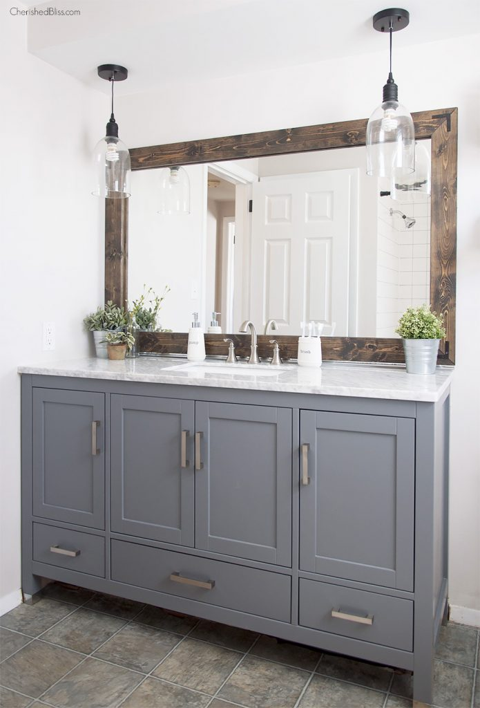 Add character to your bathroom with this DIY Farmhouse Style Bathroom Mirror Tutorial