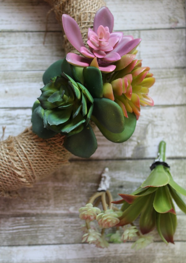 I have a confession to make. I don't have a green thumb. In fact, I can't keep plants alive no matter how hard I try, even succulents. That's why the DIY Succulent Wreath we're featuring this week is the perfect craft for me. Katie used faux succulents for this darling spring wreath and I think it looks perfect. Check it out!