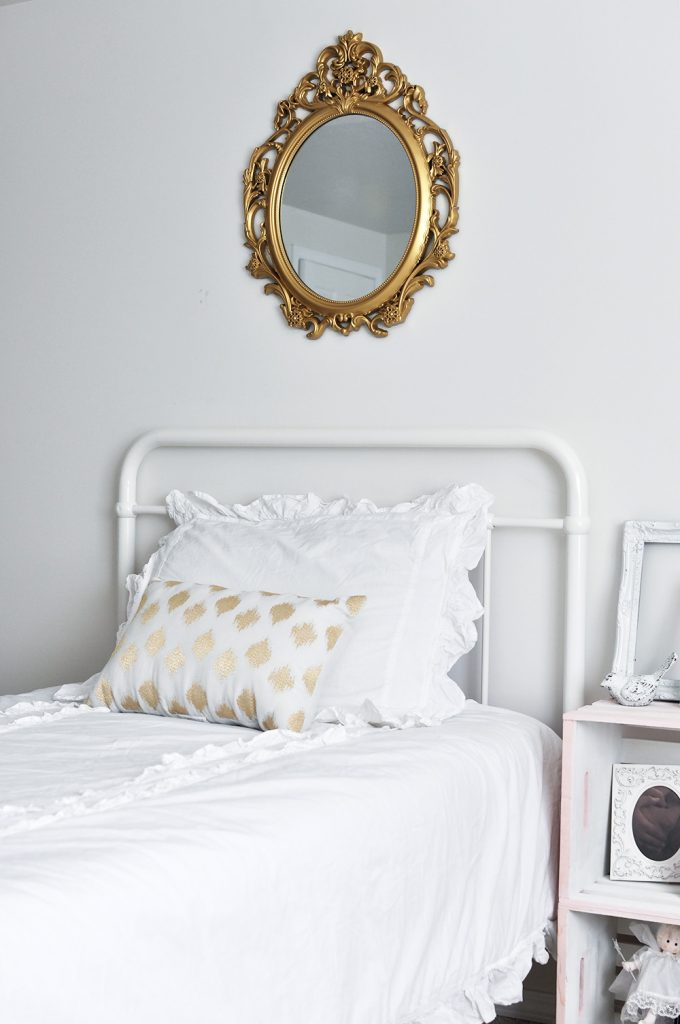 This gorgeous white Feminine Vintage Chic Bedroom is perfect for any little girl who wants to feel like a big girl with touches of pink and gold.