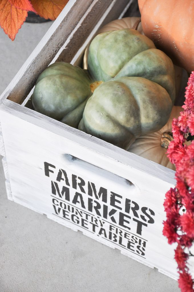 Create this beautiful DIY Fall Farmhouse Crate with a ready made crate, paint and a stencil. The perfect way to provide a farmhouse feel to your Fall Decor.