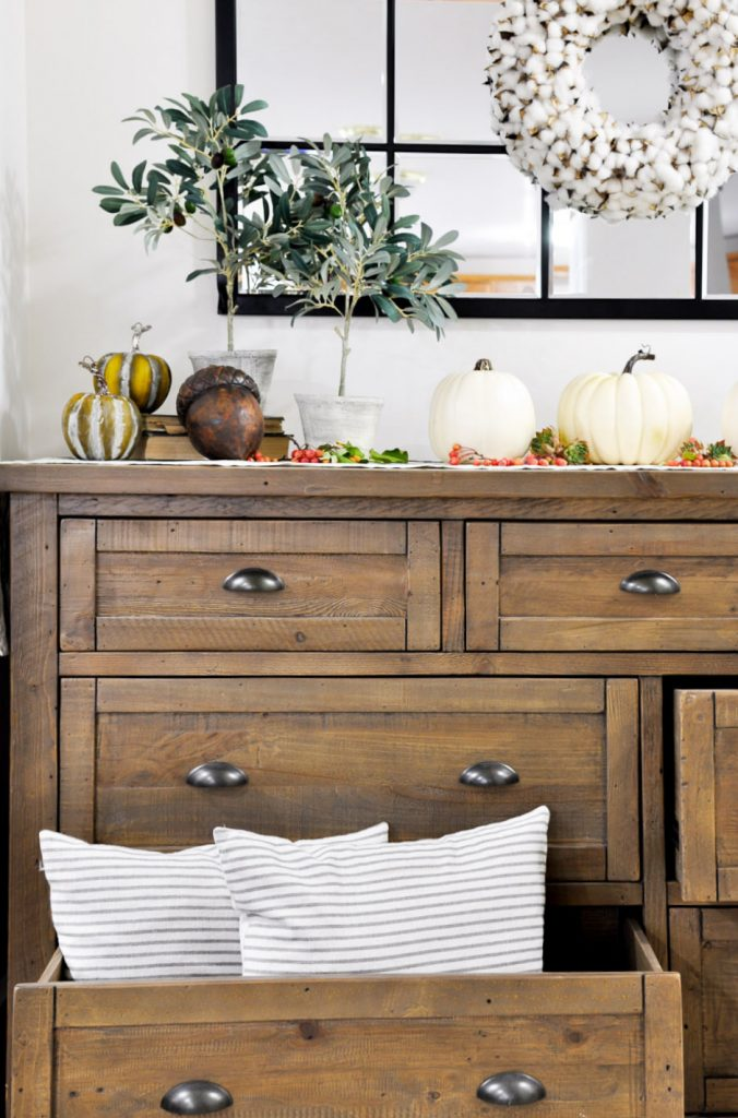 Create a beautiful space with these simple tips on creating a Welcoming Fall Entryway that can double as storage without sacrificing style!