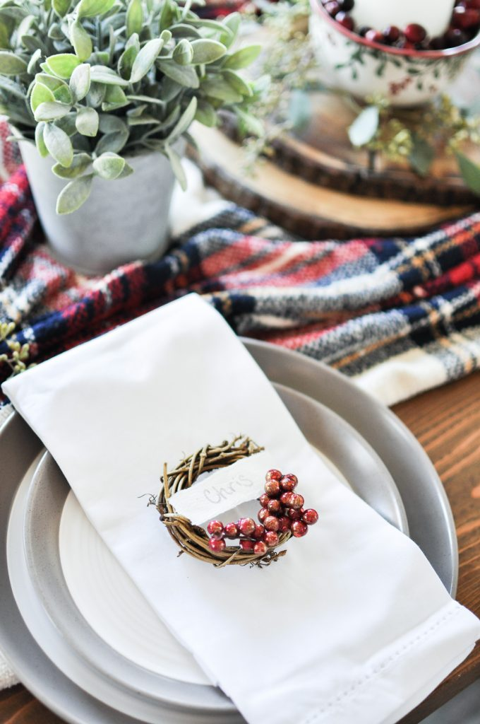 This quick and easy craft is the perfect addition to your holiday table. Make your guests feel welcome with their very own Mini Wreath Christmas Place Card!