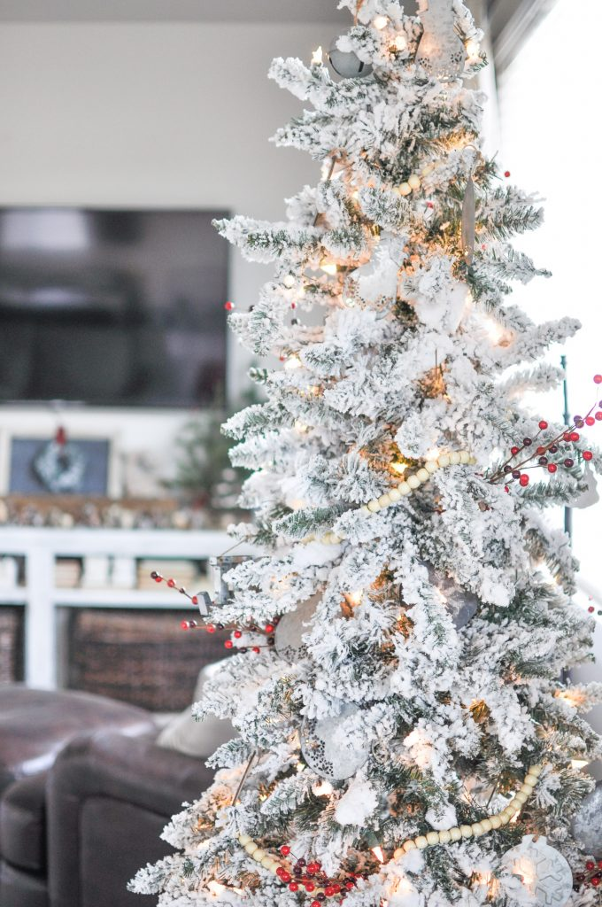 This beautiful Modern Farmhouse Christmas Tree was easily created with chalkboard and galvanized metal ornaments followed by a few hints of red.