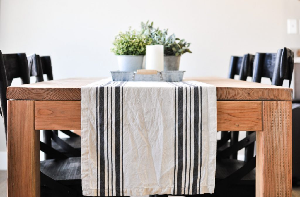 This Modern Farmhouse Dining Room Table is the perfect addition to any dining space. With these free plans you will be on your way to the dining room of your dreams!