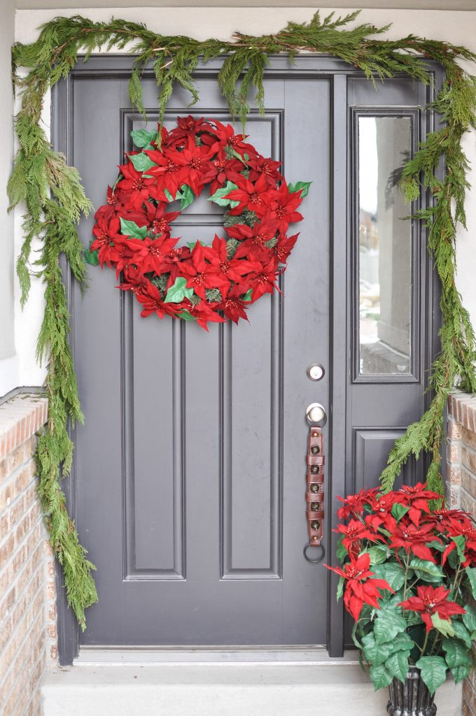 red and green classic christmas porch cherished bliss looking for simple porch decorating ideas create a classic appeal with these traditional poinsettias and