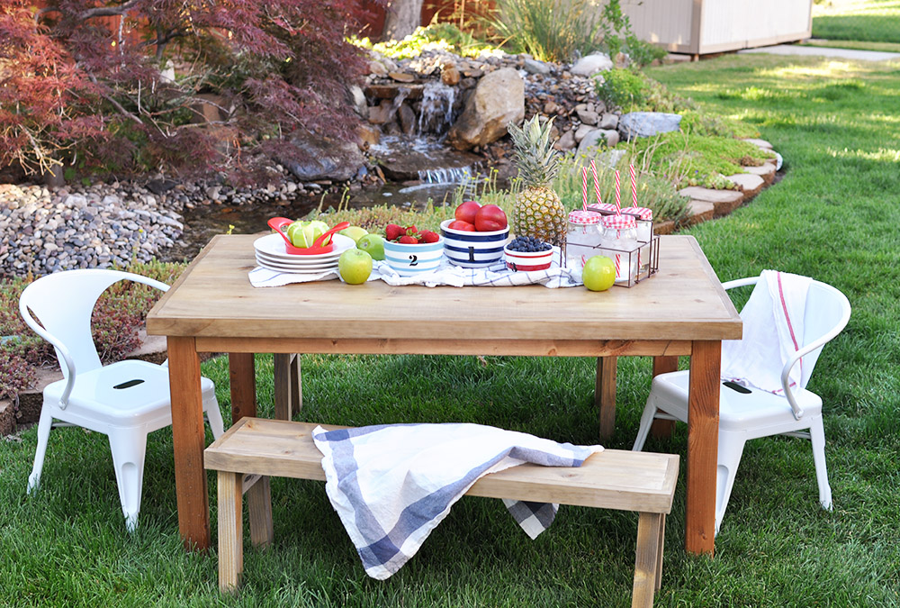 Give your kids an outdoor oasis with this easy to follow tutorial! Learn how to build this DIY Kids Outdoor Table and customize it to any style!