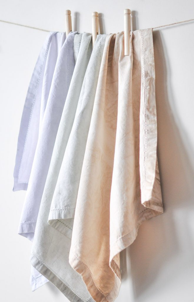 Enhance your next home decor project by learning how to dye fabric with milk paint and provide a timeless look for any project big or small!