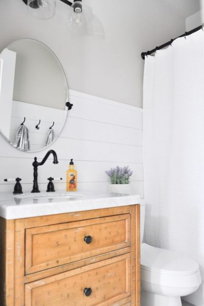 This light and airy bathroom is the perfect way to transform a small stuffy space into something you will love. Visit the post to get all the details on this Modern Farmhouse Bathroom.