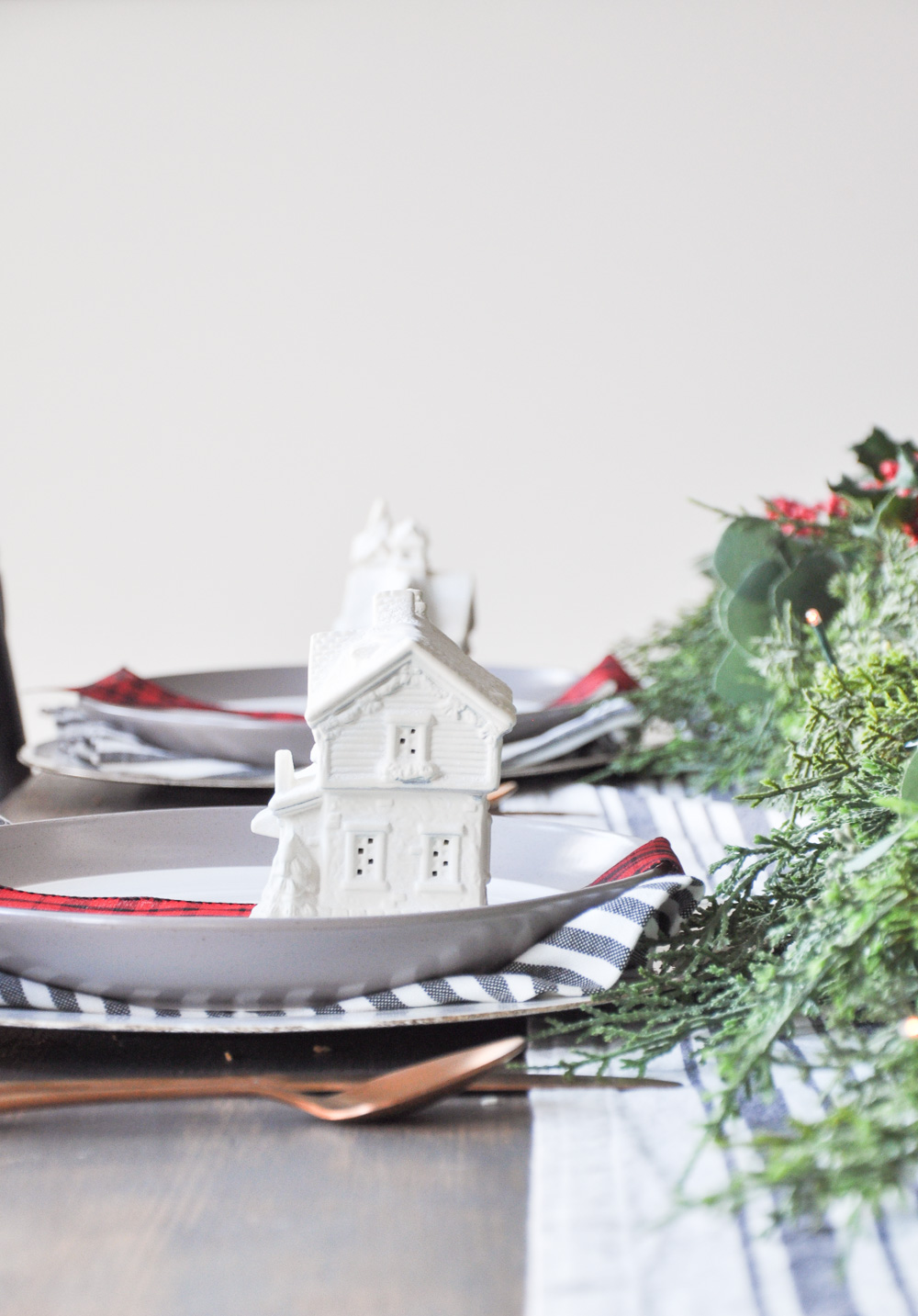 This unique Christmas Village Holiday Tablescape provides a simple way to bring a little Christmas Cheer to your home using things you likely have on hand!