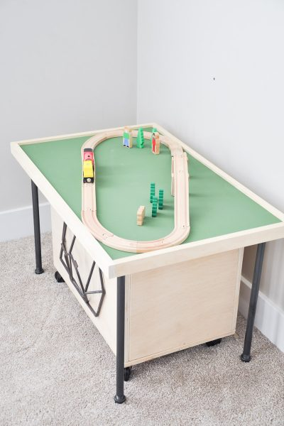 Do your kids love train tables but you don't have the space? This smaller, easily stored Space Saving DIY Train Table is the perfect solution!