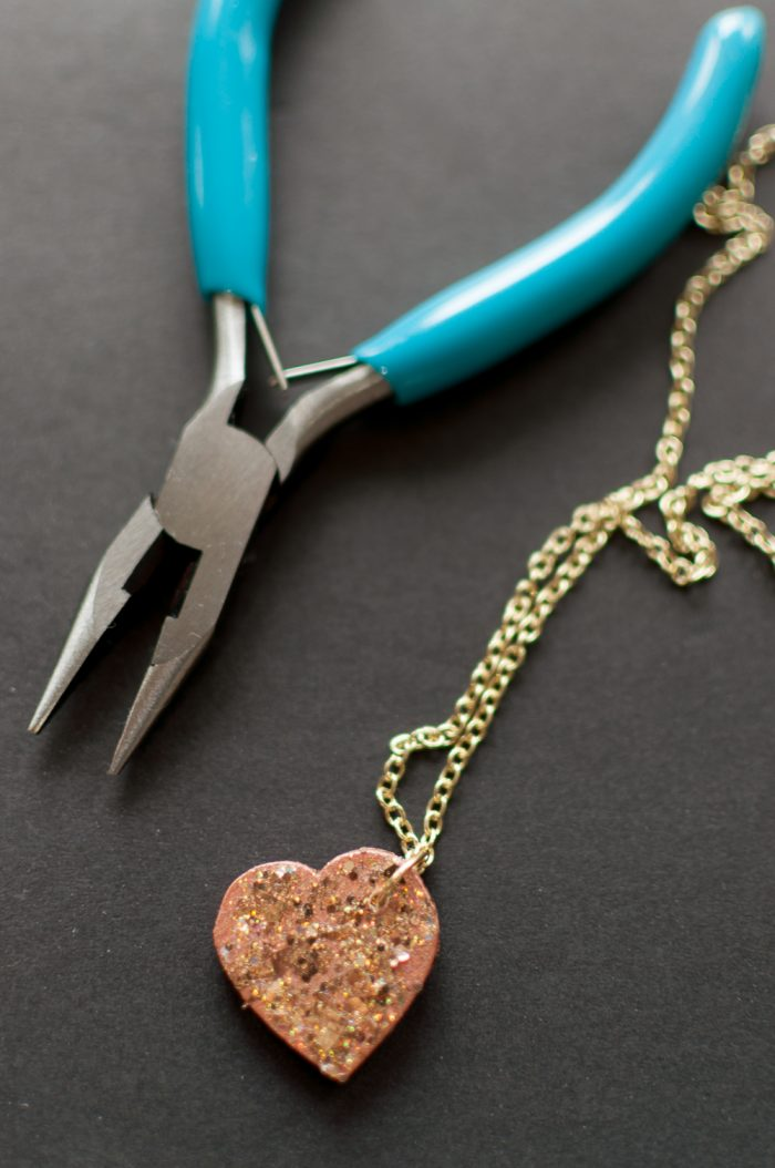Glitter doesn't have to be messy! With this new Glitterific Paint you can create this DIY Glitter Heart Necklace in just a few easy steps!