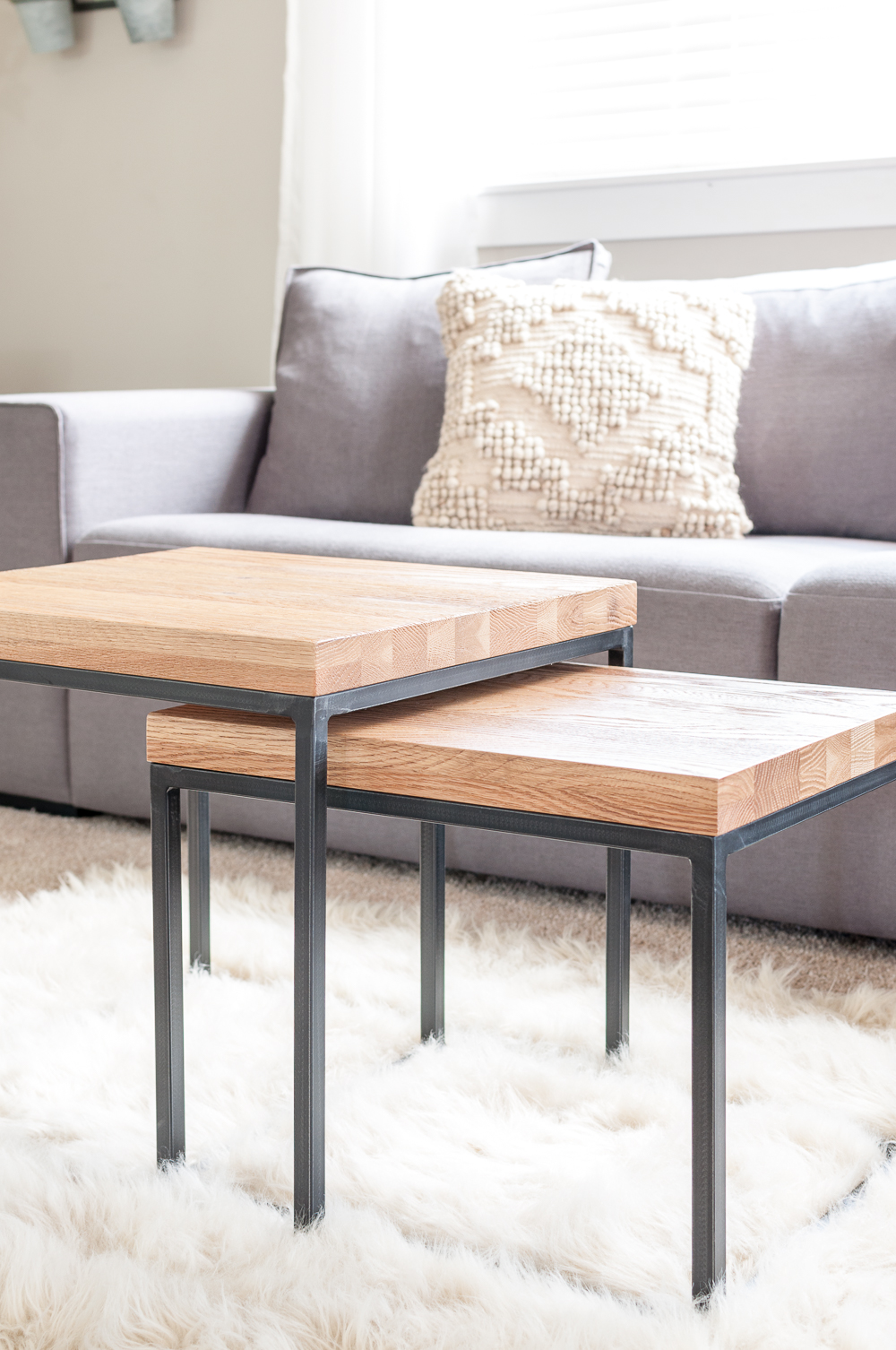 Nesting tables are the perfect addition to a minimalist living room providing surfaces that can also be space saving!