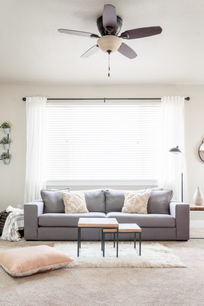 Trying to achieve a simpler feel in your home? This Minimalist Living Room makeover provides a clean look while still maintaining the cozy feel we all love in our homes!