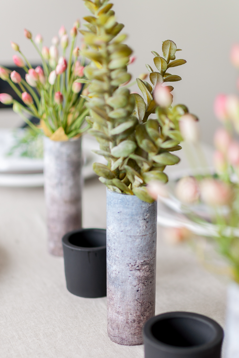Use a little Dishwasher Safe Mod Podge to completely transform these small glass vases into a Faux Concrete Vase! This is such an easy and affordable project, visit Cherished Bliss for the how-to!
