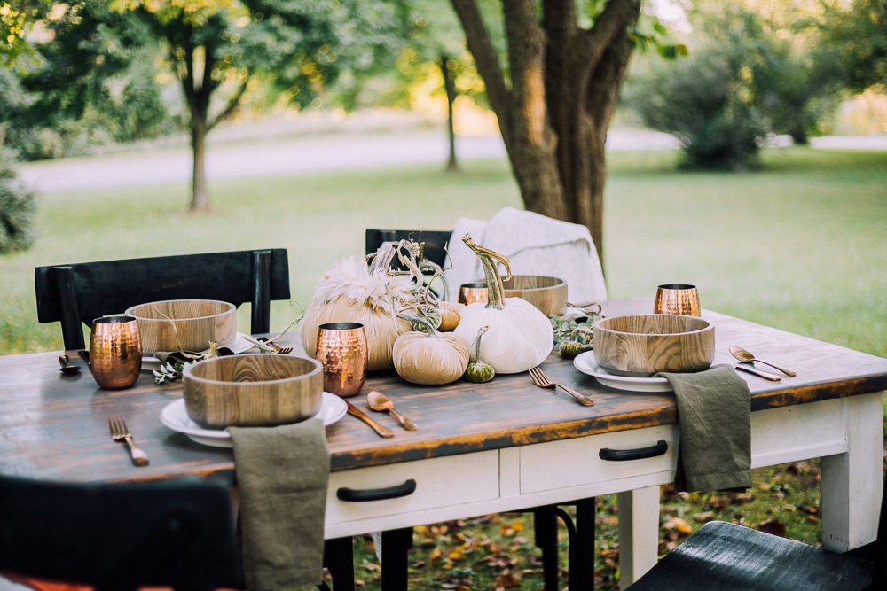 Create a cozy and beautiful outdoor fall tablescape with warm textures using these velvet pumpkins, the perfect addition to your fall decor!
