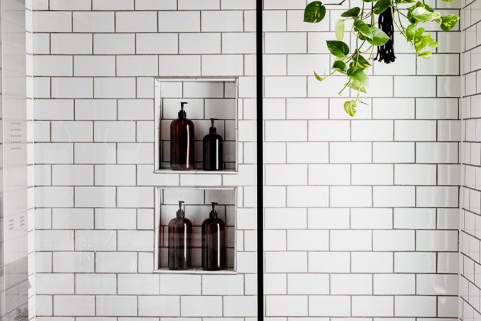 Shower storage in an industrial bathroom