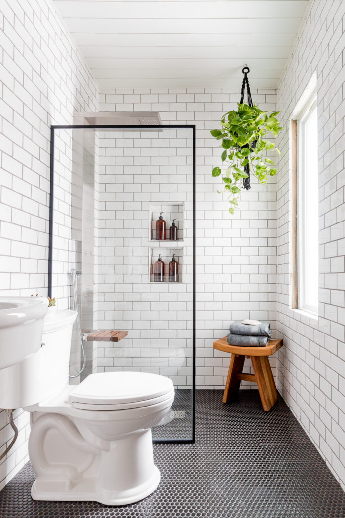 Come take a tour of this Black and White Industrial Bathroom before and after. This is proof small bathrooms can be luxurious.