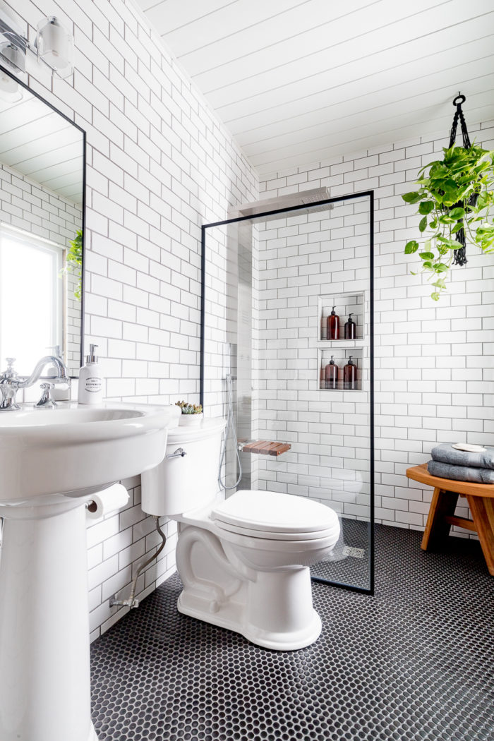 Use a shower screen in a bathroom to make the room feel bigger like this industrial bathroom.