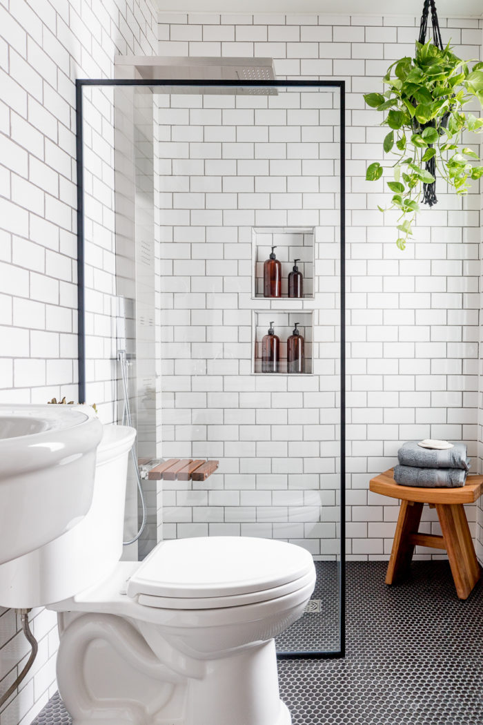 Hang plants in an industrial bathroom for an organic feel!