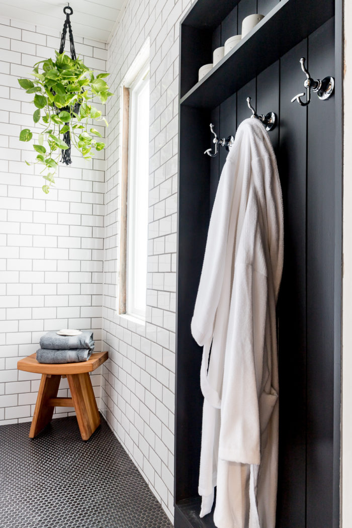 Beautiful place to hang towels in this industrial bathroom