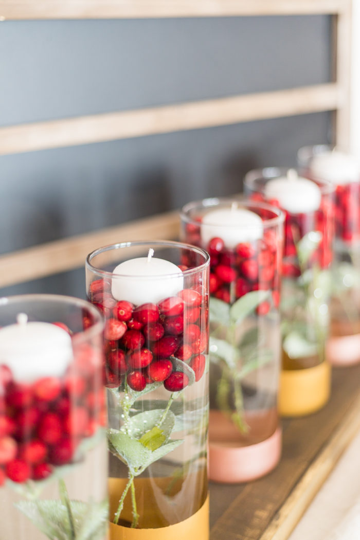 Create this gorgeous Cranberry Holiday Centerpiece using just a few craft supplies and easily transition from Thanksgiving to Christmas.