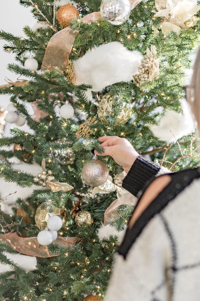 Learn how to decorate a Christmas tree with these easy steps. Ashley walks you through the simple process of recreating this Cozy Metallic Christmas tree as part of the Home Depot Holiday Style Challenge.