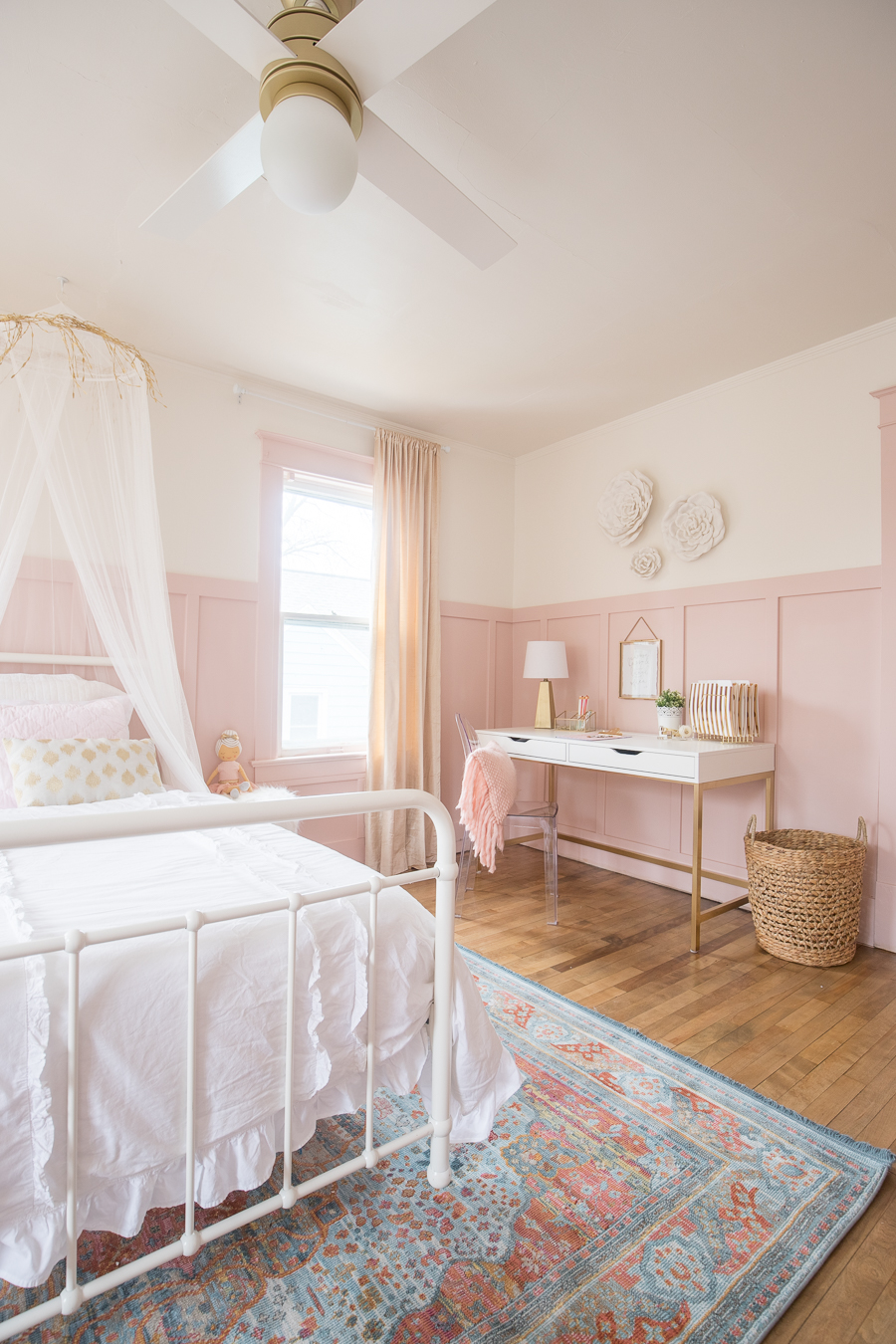 A beautiful Pink and Gold Girls Bedroom with a modern yet delicate touch, fun seating, and functional desk space perfect for all ages!