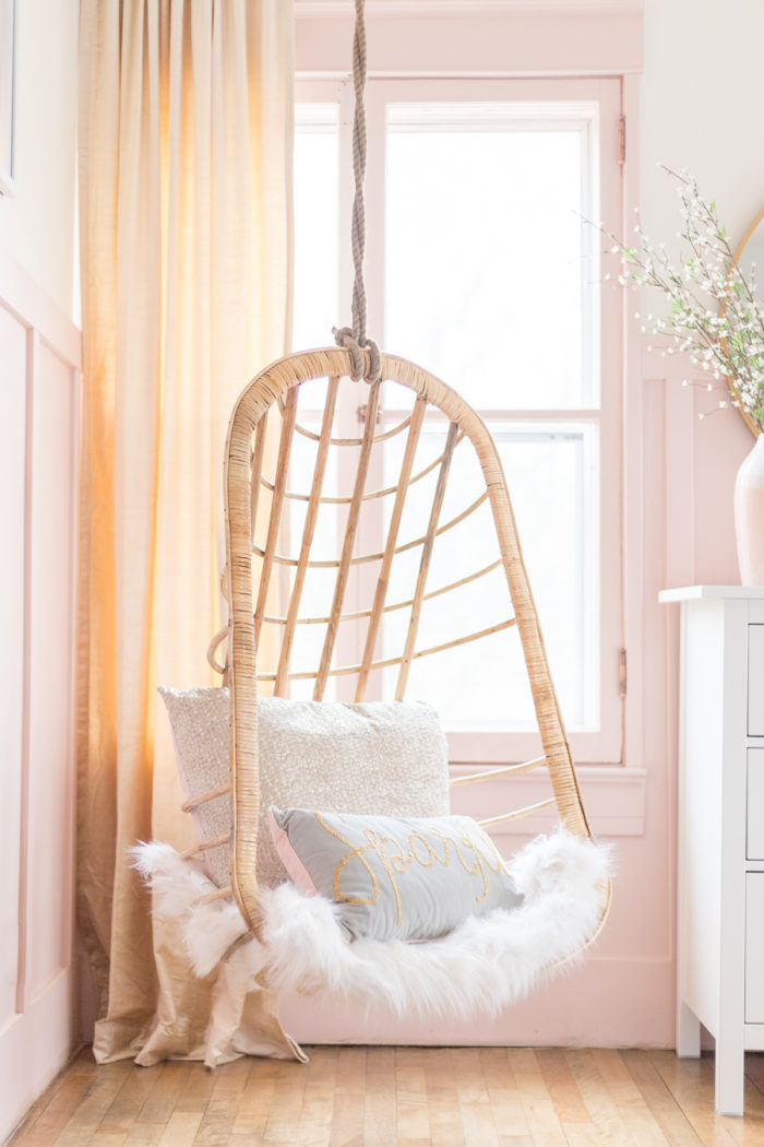Hanging Wicker Chair In Pink And Gold Girls Bedroom