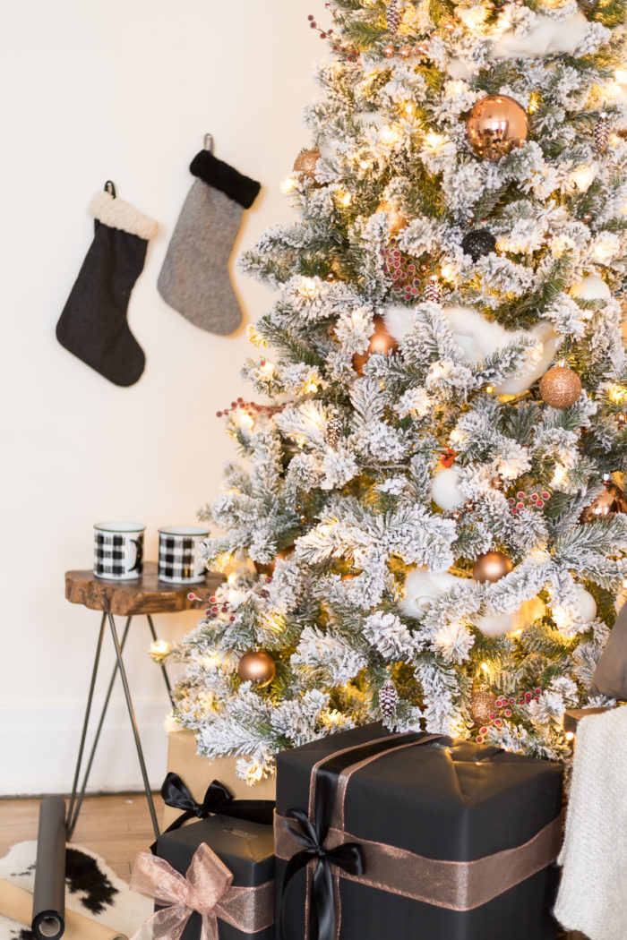 This Flocked White and Copper Christmas Tree brings coziness into any space! Learn how to decorate a tree with these simple tips!