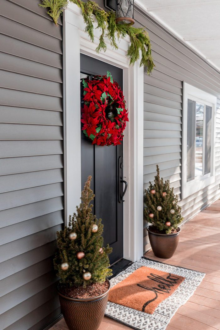 Completely transform the front of your house with these simple tips to refresh your winter front door decor and hardware.
