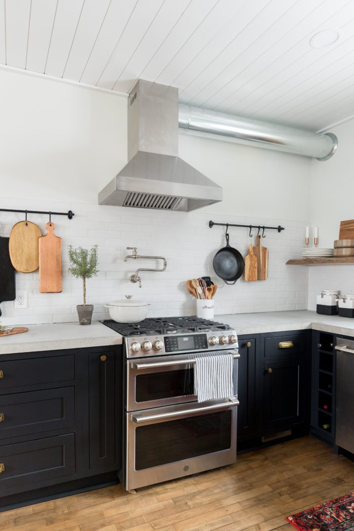 open shelving and industrial appliance complete this rustic modern kitchen